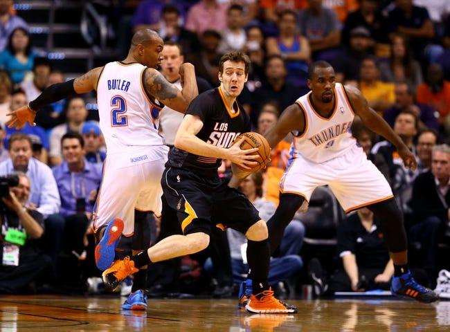 Mar 6, 2014; Phoenix, AZ, USA; Phoenix Suns guard Goran Dragic (center) controls the ball in the second quarter against the Oklahoma City Thunder at the US Airways Center. Mandatory Credit: Mark J. Rebilas-USA TODAY Sports