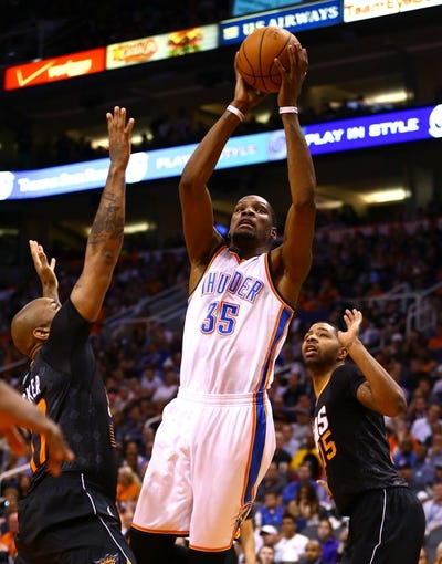 Mar 6, 2014; Phoenix, AZ, USA; Oklahoma City Thunder forward Kevin Durant (35) drives to the basket in the second quarter against the Phoenix Suns at the US Airways Center. Mandatory Credit: Mark J. Rebilas-USA TODAY Sports