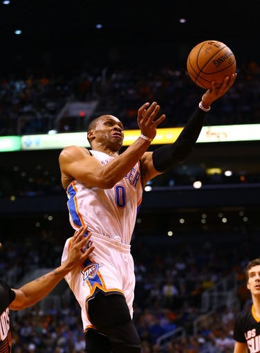 Mar 6, 2014; Phoenix, AZ, USA; Oklahoma City Thunder guard Russell Westbrook drives to the basket in the second quarter against the Phoenix Suns at the US Airways Center. Mandatory Credit: Mark J. Rebilas-USA TODAY Sports