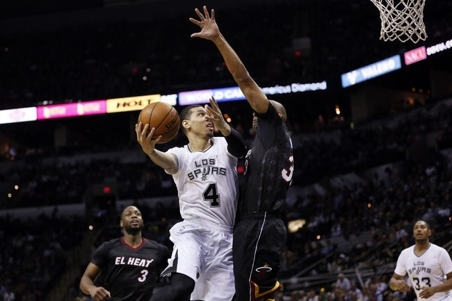 Mar 6, 2014; San Antonio, TX, USA; San Antonio Spurs guard Danny Green (4) shoots the ball while being defended by Miami Heat forward Shane Battier (right) during the second half at AT&T Center. The Spurs won 111-87. Mandatory Credit: Soobum Im-USA TODAY Sports
