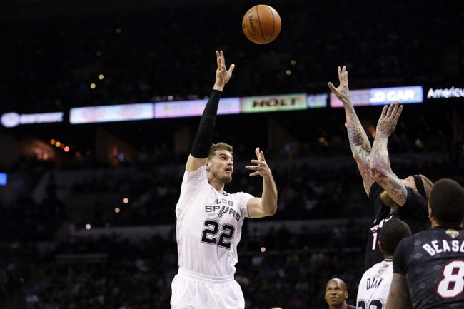 Mar 6, 2014; San Antonio, TX, USA; San Antonio Spurs forward Tiago Splitter (22) puts up a shot over Miami Heat forward Chris Andersen (11) during the second half at AT&T Center. The Spurs won 111-87. Mandatory Credit: Soobum Im-USA TODAY Sports