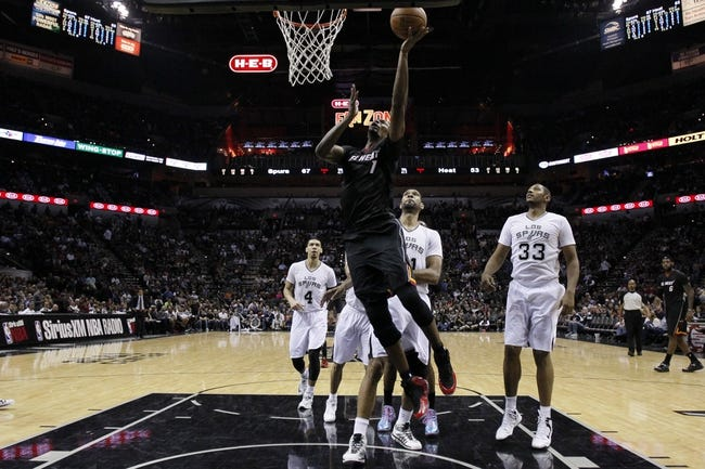 Mar 6, 2014; San Antonio, TX, USA; Miami Heat center Chris Bosh (1) shoots the ball against the San Antonio Spurs during the second half at AT&T Center. The Spurs won 111-87. Mandatory Credit: Soobum Im-USA TODAY Sports