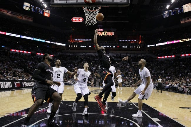 Mar 6, 2014; San Antonio, TX, USA; Miami Heat guard Dwyane Wade (3) shoots the ball against the San Antonio Spurs during the second half at AT&T Center. The Spurs won 111-87. Mandatory Credit: Soobum Im-USA TODAY Sports