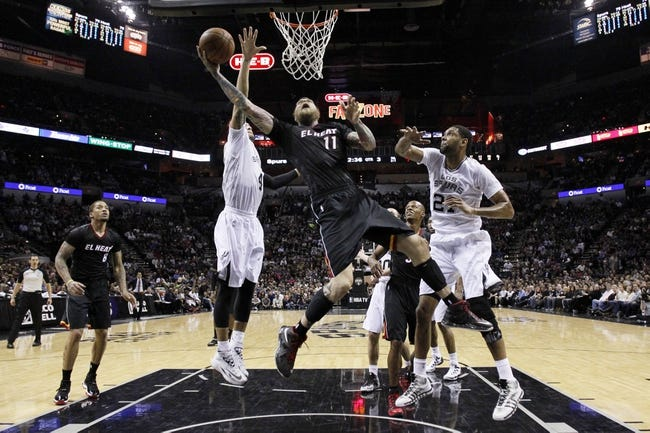 Mar 6, 2014; San Antonio, TX, USA; Miami Heat forward Chris Andersen (11) shoots the ball past San Antonio Spurs forward Tim Duncan (21) and guard Danny Green (4) during the second half at AT&T Center. The Spurs won 111-87. Mandatory Credit: Soobum Im-USA TODAY Sports