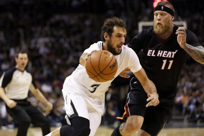 Mar 6, 2014; San Antonio, TX, USA; San Antonio Spurs forward Marco Belinelli (3) drives to the basket past Miami Heat forward Chris Andersen (11) during the second half at AT&T Center. The Spurs won 111-87. Mandatory Credit: Soobum Im-USA TODAY Sports