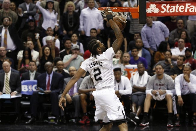 Mar 6, 2014; San Antonio, TX, USA; San Antonio Spurs forward Kawhi Leonard (2) dunks the ball against the Miami Heat during the second half at AT&T Center. The Spurs won 111-87. Mandatory Credit: Soobum Im-USA TODAY Sports
