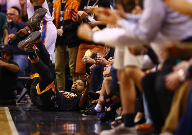 Mar 6, 2014; Phoenix, AZ, USA; Phoenix Suns forward Marcus Morris reacts after falling out of bounds while making a shot in the fourth quarter against the Oklahoma City Thunder at the US Airways Center. The Suns defeated the Thunder 128-122. Mandatory Credit: Mark J. Rebilas-USA TODAY Sports