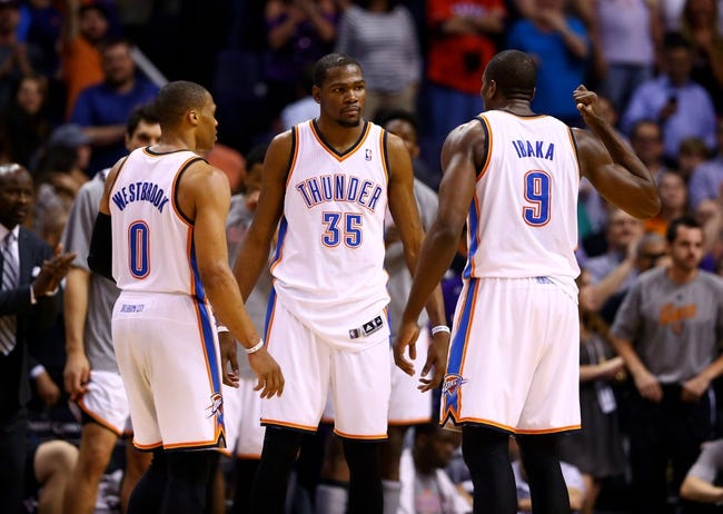 Mar 6, 2014; Phoenix, AZ, USA; Oklahoma City Thunder guard Russell Westbrook (0) and forward Kevin Durant (35) argue with forward Serge Ibaka (9) in the closing seconds of the fourth quarter against the Phoenix Suns at the US Airways Center. The Suns defeated the Thunder 128-122. Mandatory Credit: Mark J. Rebilas-USA TODAY Sports