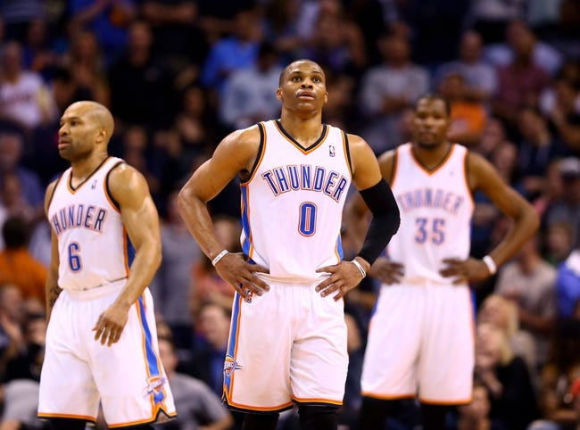 Mar 6, 2014; Phoenix, AZ, USA; Oklahoma City Thunder guard Russell Westbrook (0), guard Derek Fisher (6) and forward Kevin Durant react in the fourth quarter against the Phoenix Suns at the US Airways Center. The Suns defeated the Thunder 128-122. Mandatory Credit: Mark J. Rebilas-USA TODAY Sports