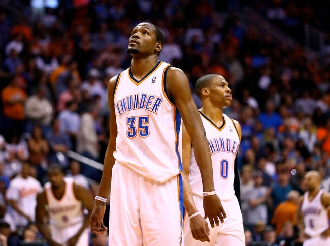 Mar 6, 2014; Phoenix, AZ, USA; Oklahoma City Thunder forward Kevin Durant (35) and guard Russell Westbrook (0) react during the fourth quarter against the Phoenix Suns at the US Airways Center. The Suns defeated the Thunder 128-122. Mandatory Credit: Mark J. Rebilas-USA TODAY Sports
