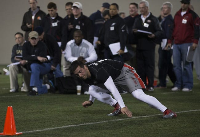 Mar 7, 2014; Columbus, OH, USA; Ohio State Buckeyes long snapper Geroge Makridis works out in front of NFL scouts on pro day  at The Woody Hayes Athletic Center. Mandatory Credit: Greg Bartram-USA TODAY Sports