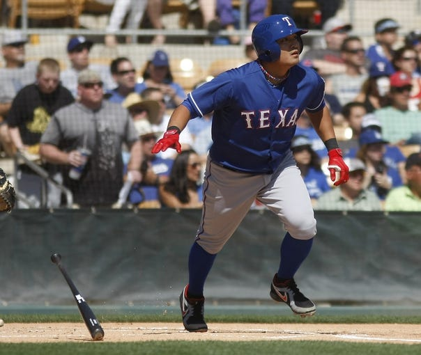 Mar 7, 2014; Phoenix, AZ, USA; Texas Rangers left fielder Shin-Soo Choo (17) doubles in the first inning against the Los Angeles Dodgers at Camelback Ranch. Mandatory Credit: Rick Scuteri-USA TODAY Sports