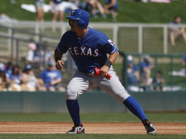Mar 7, 2014; Phoenix, AZ, USA; Texas Rangers left fielder Shin-Soo Choo (17) leads off secondbase in the first inning against the Los Angeles Dodgers at Camelback Ranch. Mandatory Credit: Rick Scuteri-USA TODAY Sports