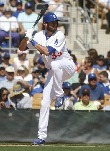 Mar 7, 2014; Phoenix, AZ, USA; Los Angeles Dodgers left fielder Scott Van Slyke (33) hits against the Texas Rangers in the first inning at Camelback Ranch. Mandatory Credit: Rick Scuteri-USA TODAY Sports