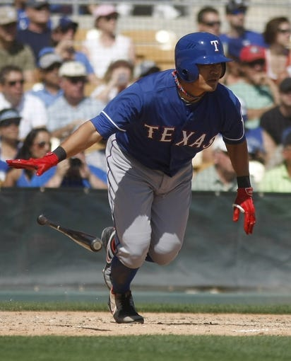 Mar 7, 2014; Phoenix, AZ, USA; Texas Rangers left fielder Shin-Soo Choo (17) hits in the third inning against the Los Angeles Dodgers at Camelback Ranch. Mandatory Credit: Rick Scuteri-USA TODAY Sports