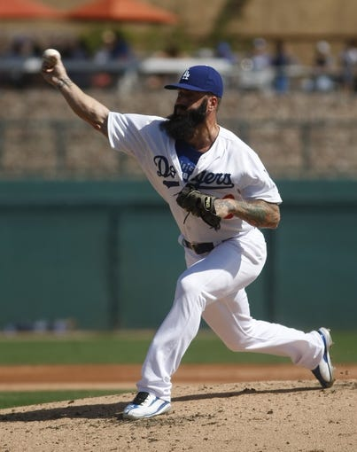 Mar 7, 2014; Phoenix, AZ, USA; Los Angeles Dodgers pitcher Brian Wilson (00) throws in the third inning against the Texas Rangers at Camelback Ranch. Mandatory Credit: Rick Scuteri-USA TODAY Sports