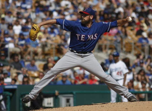 Mar 7, 2014; Phoenix, AZ, USA; Texas Rangers relief pitcher Michael Kirkman (50) throws in the fifth inning against the Los Angeles Dodgers at Camelback Ranch. Mandatory Credit: Rick Scuteri-USA TODAY Sports