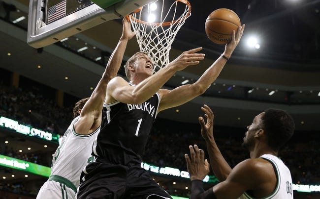 Mar 7, 2014; Boston, MA, USA; Brooklyn Nets power forward Mason Plumlee (1) goes to the basket past Boston Celtics small forward Jeff Green (8) during the first quarter at TD Garden. Mandatory Credit: Winslow Townson-USA TODAY Sports