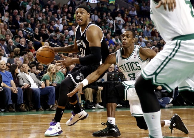 Mar 7, 2014; Boston, MA, USA; Boston Celtics point guard Rajon Rondo (9) tries to steal the ball from Brooklyn Nets small forward Paul Pierce (34) during the first quarter at TD Garden. Mandatory Credit: Winslow Townson-USA TODAY Sports