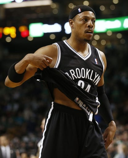 Mar 7, 2014; Boston, MA, USA; Brooklyn Nets small forward Paul Pierce (34) un tucks his shirt after they lost to the Boston Celtics 91-84 at TD Garden. Mandatory Credit: Winslow Townson-USA TODAY Sports