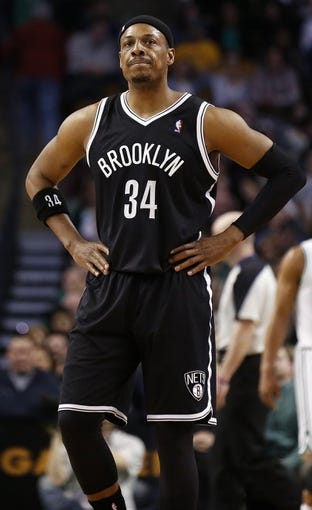 Mar 7, 2014; Boston, MA, USA; Brooklyn Nets small forward Paul Pierce (34) walks back up court after missing a shot during the second half of their 91-84 loss to the Boston Celtics at TD Garden. Mandatory Credit: Winslow Townson-USA TODAY Sports