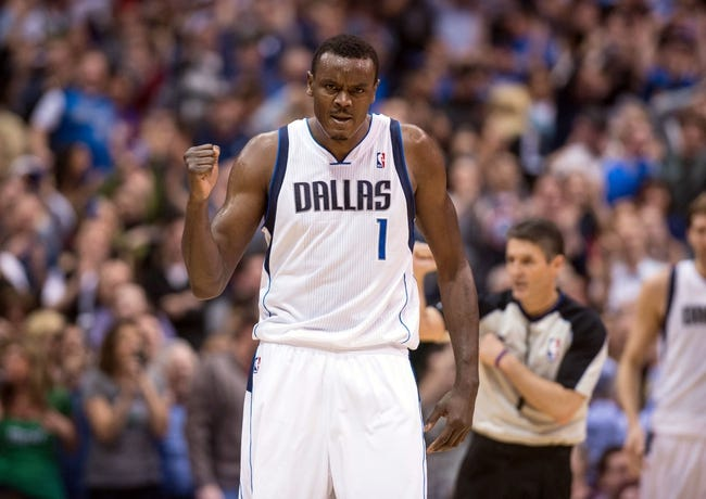 Mar 7, 2014; Dallas, TX, USA; Dallas Mavericks center Samuel Dalembert (1) celebrates during the second half against the Portland Trail Blazers at the American Airlines Center. The Mavericks defeated the Trail Blazers 103-98. Mandatory Credit: Jerome Miron-USA TODAY Sports