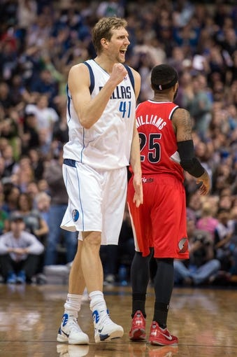 Mar 7, 2014; Dallas, TX, USA; Dallas Mavericks power forward Dirk Nowitzki (41) celebrates during the second half against the Portland Trail Blazers at the American Airlines Center. The Mavericks defeated the Trail Blazers 103-98. Mandatory Credit: Jerome Miron-USA TODAY Sports