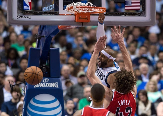 Mar 7, 2014; Dallas, TX, USA; Dallas Mavericks shooting guard Vince Carter (25) dunks the ball as Portland Trail Blazers center Robin Lopez (42) defends during the second half at the American Airlines Center. The Mavericks defeated the Trail Blazers 103-98. Mandatory Credit: Jerome Miron-USA TODAY Sports