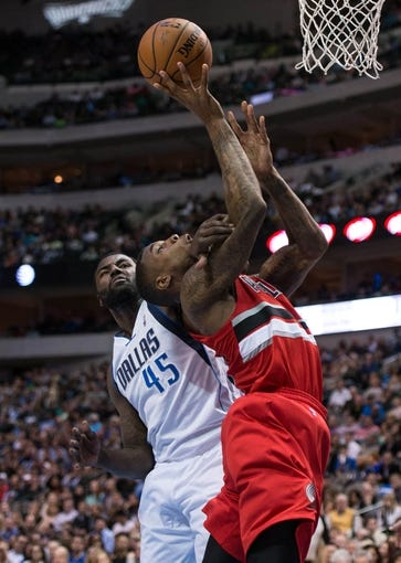 Mar 7, 2014; Dallas, TX, USA; Dallas Mavericks center DeJuan Blair (45) is called for a flagrant foul on Portland Trail Blazers power forward Thomas Robinson (41) during the second half at the American Airlines Center. The Mavericks defeated the Trail Blazers 103-98. Mandatory Credit: Jerome Miron-USA TODAY Sports
