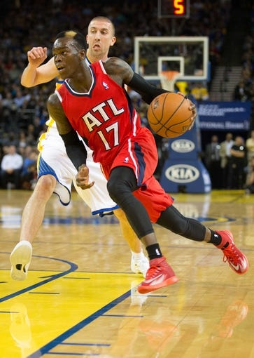 Mar 7, 2014; Oakland, CA, USA; Atlanta Hawks point guard Dennis Schroder (17) drives in against Golden State Warriors point guard Steve Blake (25) during the second quarter at Oracle Arena. Mandatory Credit: Kelley L Cox-USA TODAY Sports