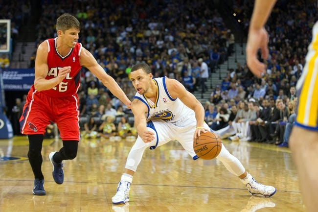 Mar 7, 2014; Oakland, CA, USA; Golden State Warriors point guard Stephen Curry (30) controls the ball against Atlanta Hawks shooting guard Kyle Korver (26) during the third quarter at Oracle Arena. The Golden State Warriors defeated the Atlanta Hawks 111-97. Mandatory Credit: Kelley L Cox-USA TODAY Sports