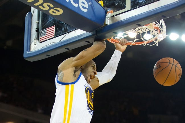 Mar 7, 2014; Oakland, CA, USA; Golden State Warriors small forward Andre Iguodala (9) on an alley oop dunk against the Atlanta Hawks during the fourth quarter at Oracle Arena. The Golden State Warriors defeated the Atlanta Hawks 111-97. Mandatory Credit: Kelley L Cox-USA TODAY Sports