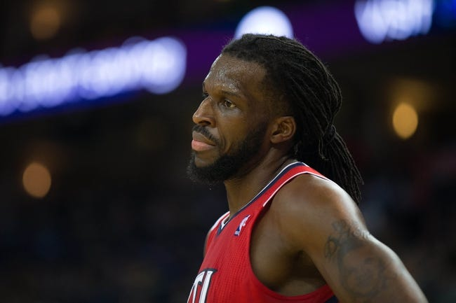 Mar 7, 2014; Oakland, CA, USA; Atlanta Hawks small forward DeMarre Carroll (5) reacts between plays against the Golden State Warriors during the third quarter at Oracle Arena. The Golden State Warriors defeated the Atlanta Hawks 111-97. Mandatory Credit: Kelley L Cox-USA TODAY Sports