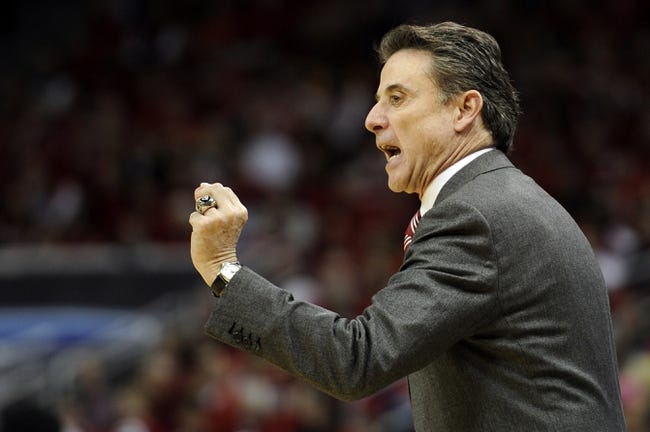 Mar 8, 2014; Louisville, KY, USA; Louisville Cardinals head coach Rick Pitino reacts during the first half against the Connecticut Huskies at KFC Yum! Center. Mandatory Credit: Jamie Rhodes-USA TODAY Sports
