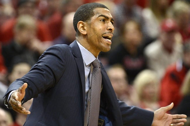 Mar 8, 2014; Louisville, KY, USA; Connecticut Huskies head coach Kevin Ollie reacts during the first half against the Louisville Cardinals at KFC Yum! Center. Mandatory Credit: Jamie Rhodes-USA TODAY Sports