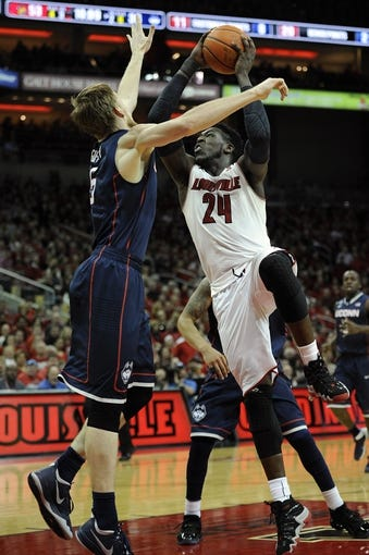 Mar 8, 2014; Louisville, KY, USA; Louisville Cardinals forward Montrezl Harrell (24) shoots against Connecticut Huskies guard/forward Niels Giffey (5) during the second half at KFC Yum! Center. Louisville defeated Connecticut 81-48.  Mandatory Credit: Jamie Rhodes-USA TODAY Sports