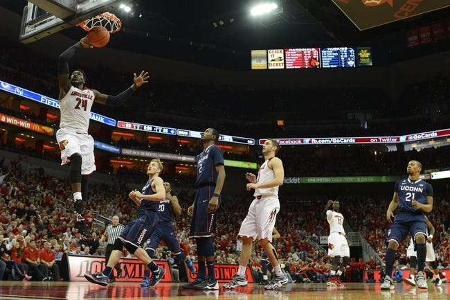 Mar 8, 2014; Louisville, KY, USA; Louisville Cardinals forward Montrezl Harrell (24) dunks against the Connecticut Huskies during the second half at KFC Yum! Center. Louisville defeated Connecticut 81-48.  Mandatory Credit: Jamie Rhodes-USA TODAY Sports