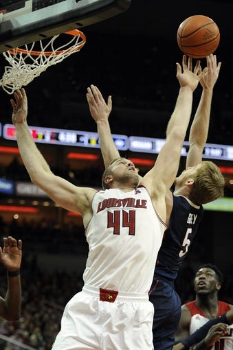Mar 8, 2014; Louisville, KY, USA; Louisville Cardinals forward Stephan Van Treese (44) battles Connecticut Huskies guard/forward Niels Giffey (5) for a rebound during the second half at KFC Yum! Center. Louisville defeated Connecticut 81-48.  Mandatory Credit: Jamie Rhodes-USA TODAY Sports