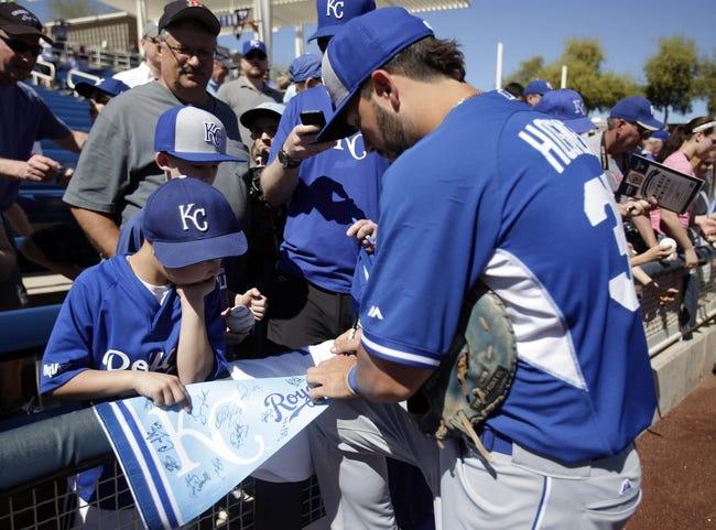 Mar 8, 2014; Phoenix, AZ, USA; Kansas City Royals first baseman Eric Hosmer (35) signs autographs before a game against the Milwaukee Brewers at Maryvale Baseball Park. Mandatory Credit: Rick Scuteri-USA TODAY Sports