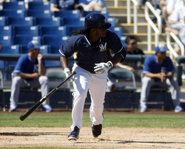 Mar 8, 2014; Phoenix, AZ, USA; Milwaukee Brewers second baseman Rickie Weeks (23) doubles against the Kansas City Royals in the first inning at Maryvale Baseball Park. Mandatory Credit: Rick Scuteri-USA TODAY Sports