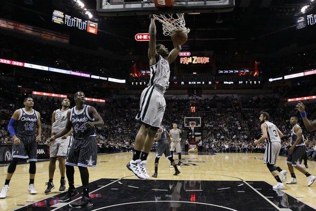 Mar 8, 2014; San Antonio, TX, USA; San Antonio Spurs forward Kawhi Leonard (2) dunks the ball against the Orlando Magic during the first half at AT&T Center. Mandatory Credit: Soobum Im-USA TODAY Sports