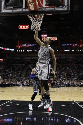 Mar 8, 2014; San Antonio, TX, USA; San Antonio Spurs forward Tim Duncan (21) shoots the ball against the Orlando Magic during the first half at AT&T Center. Mandatory Credit: Soobum Im-USA TODAY Sports