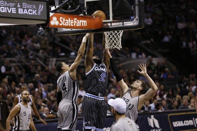 Mar 8, 2014; San Antonio, TX, USA; Orlando Magic forward Kyle O'Quinn (2) shoots the ball as San Antonio Spurs guard Danny Green (4) and forward Tiago Splitter (22) defend during the second half at AT&T Center. The Spurs won 121-112. Mandatory Credit: Soobum Im-USA TODAY Sports