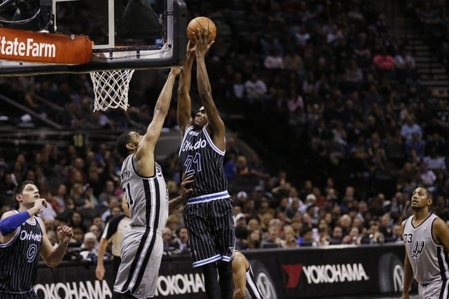 Mar 8, 2014; San Antonio, TX, USA; Orlando Magic forward Maurice Harkless (21) drives to the basket under pressure from San Antonio Spurs forward Tim Duncan (21) during the second half at AT&T Center. The Spurs won 121-112. Mandatory Credit: Soobum Im-USA TODAY Sports