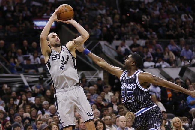 Mar 8, 2014; San Antonio, TX, USA; San Antonio Spurs guard Manu Ginobili (20) shots the ball over Orlando Magic guard E'Twaun Moore (55) during the second half at AT&T Center. The Spurs won 121-112. Mandatory Credit: Soobum Im-USA TODAY Sports