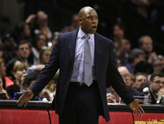 Mar 8, 2014; San Antonio, TX, USA; Orlando Magic head coach Jacque Vaughn talks to his players during the second half against the San Antonio Spurs at AT&T Center. The Spurs won 121-112. Mandatory Credit: Soobum Im-USA TODAY Sports