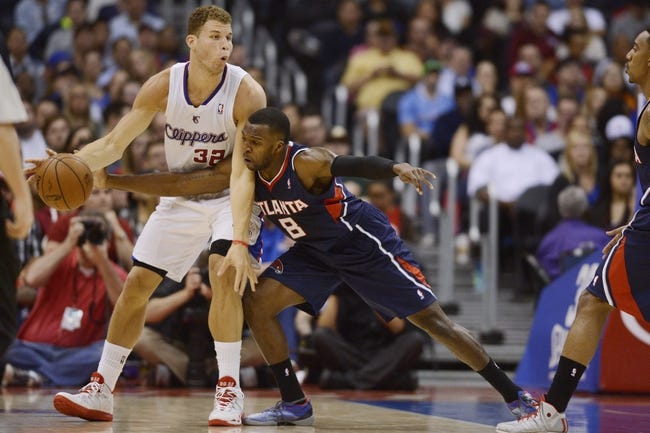 Mar 8, 2014; Los Angeles, CA, USA; Atlanta Hawks guard Shelvin Mack (8) steals the ball from Los Angeles Clippers forward Blake Griffin (32) during the second quarter at Staples Center. Mandatory Credit: Kelvin Kuo-USA TODAY Sports