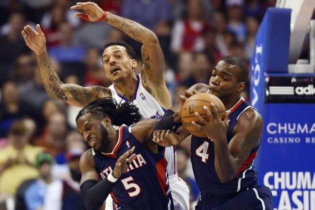 Mar 8, 2014; Los Angeles, CA, USA; Atlanta Hawks forward Paul Millsap (4) and forward DeMarre Carroll (5) and Los Angeles Clippers forward Matt Barnes (22) battle for the rebound during the second quarter at Staples Center. Mandatory Credit: Kelvin Kuo-USA TODAY Sports