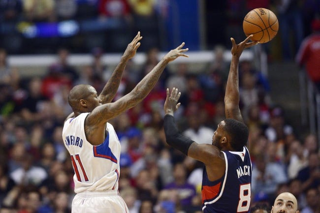 Mar 8, 2014; Los Angeles, CA, USA; Los Angeles Clippers guard Jamal Crawford (11) attempts to pass the ball tipped by Atlanta Hawks guard Shelvin Mack (8) during the second quarter at Staples Center. Mandatory Credit: Kelvin Kuo-USA TODAY Sports