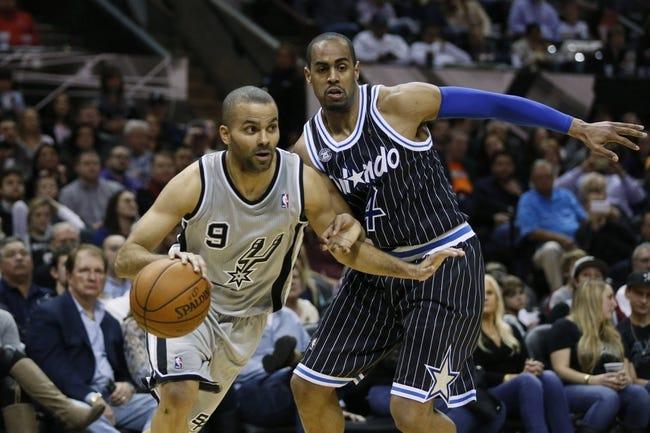 Mar 8, 2014; San Antonio, TX, USA; San Antonio Spurs guard Tony Parker (9) drives to the basket past Orlando Magic guard Arron Afflalo (4) during the second half at AT&T Center. Mandatory Credit: Soobum Im-USA TODAY Sports